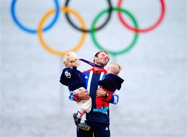 Silver medalist Nick Dempsey of Great Britain celebrates with his children Thomas-Flynn, left, and Oscar following the Men's RS:X Sailing on Day 11 of the London 2012 Olympic Games in Weymouth, England. (Laurence Griffiths / Getty Images)
