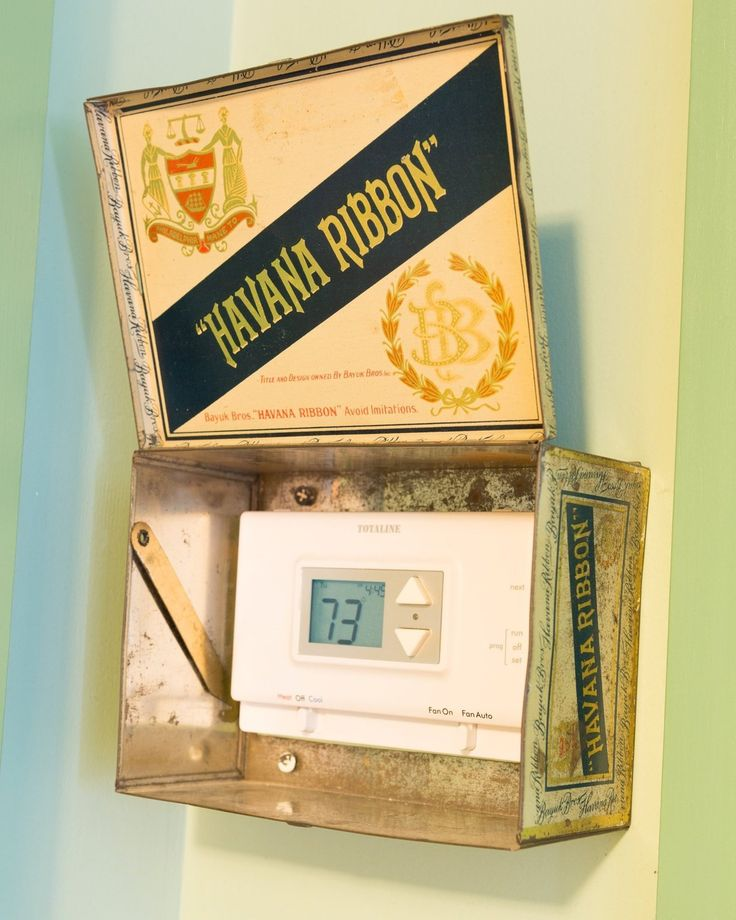 Thermostat hidden by a cigar box - clever, clever!