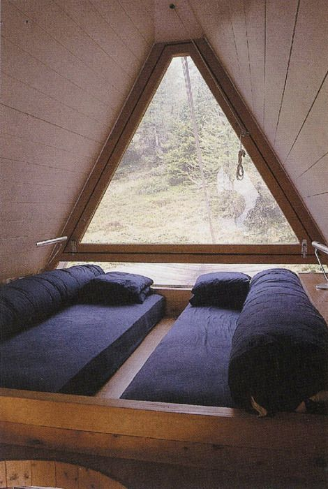 Floor sitter's / sleeping loft with triangle window. I love this *so* much...