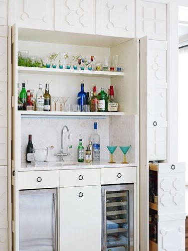 Super fun bar!  Interior design by Skip Sroka.  Photos by Werner Straube for Traditional Home.