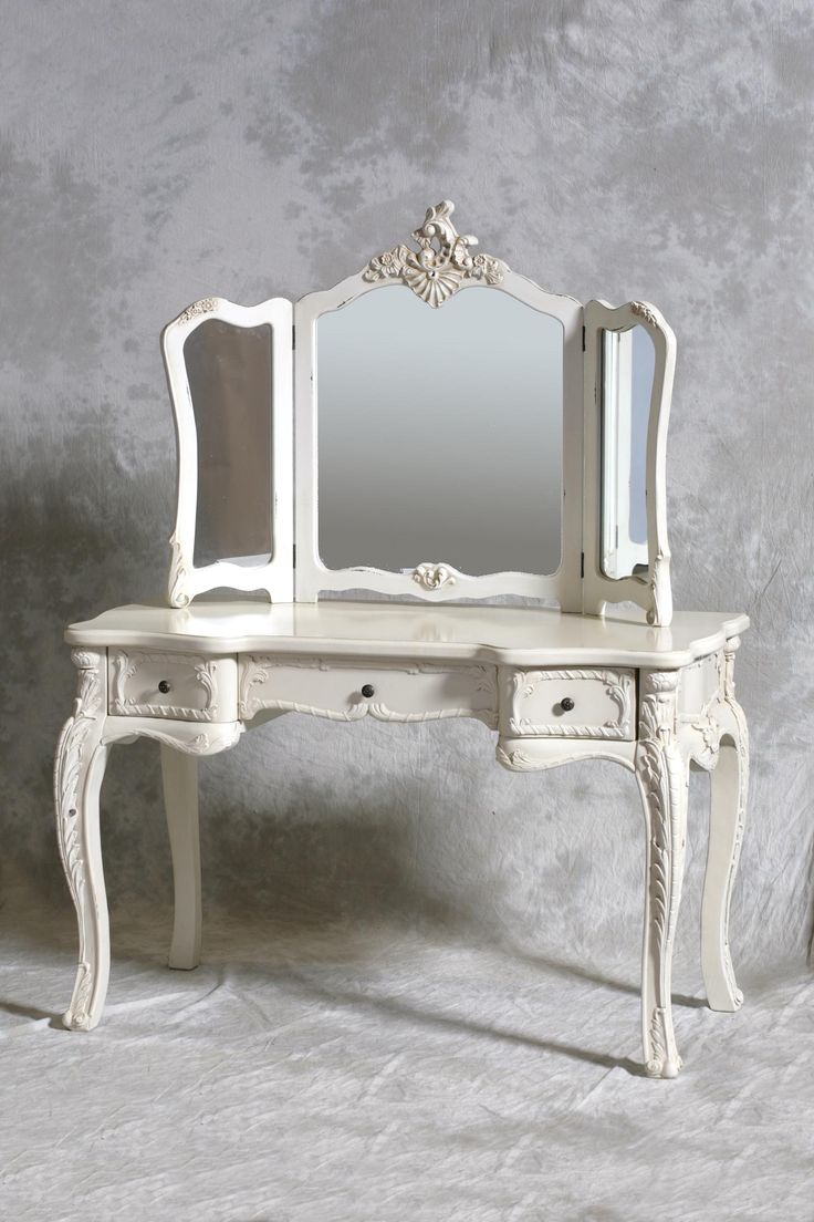 A Chateau French antique style cream dressing table & 3 fold mirror is a gorgeous French style cream dressing table and decorative triple mirror.