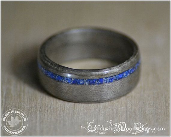 A wooden ring made from Grey Maple, with an offset Lapis Lazuli inlay. Made to…