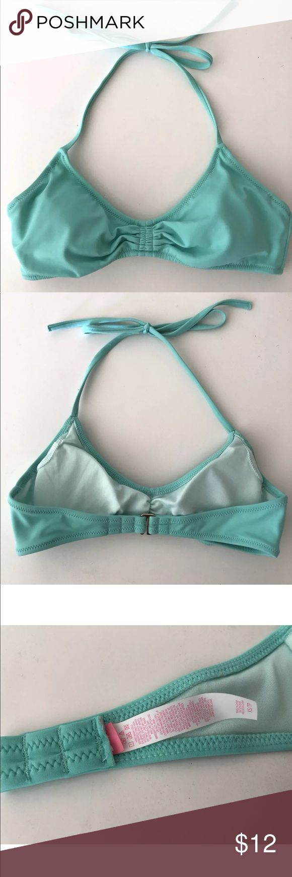 Victoria's Secret Mint Green Halter Bikini Top XS Victoria's Secret halter style bikini swim top with ruched detail at center, V shaped neckline, halter tie straps, 3 slot claw clasp in back and removable cups included. Mint green light turquoise color. Excellent preowned condition , only tried on never wore out - inner VS brand tag has been removed but care instructions and content tag remain. Victoria's Secret Swim Bikinis