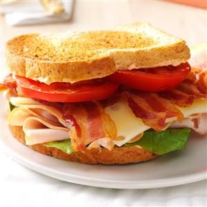 Chipotle Turkey Club Sandwich Recipe -We're crazy for BLTs. A nearby roadside stand carries gorgeous tomatoes every summer. We load up, then stuff our sandwiches with the usual suspects, plus smoked turkey and cheese. —Pamela Shank, Parkersburg, West Virginia