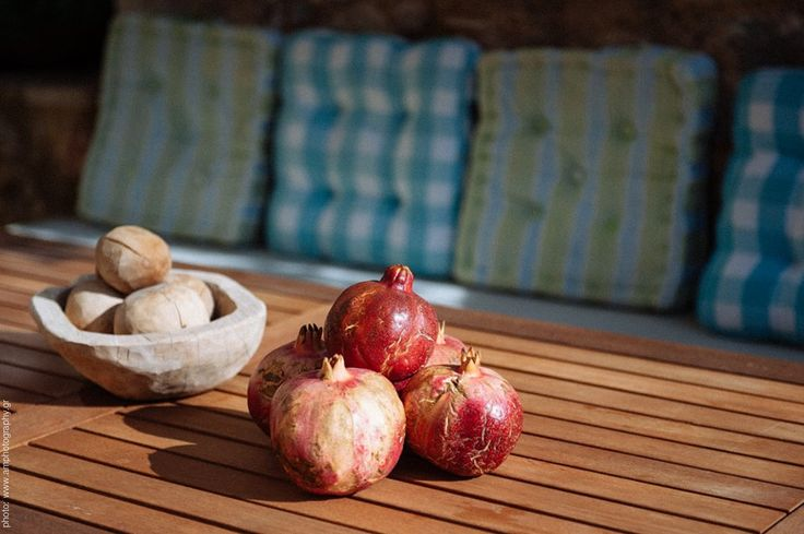 pomegranates as a autumn table decoration. rustic style by www.amphotography.gr