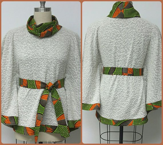Il s'agit d'une Boucle en tricot - africain veste Cap. Vous pouvez coupler le dessus avec des pantalons, jupes et robes. Il va sûrement améliorer votre garde-robe. Top fini est de 28 pouces.   INCLUS : • Un haut Modèle porte la taille 16. Dautres tailles disponibles dans dautres tissus  DÉTAILS : • Imprimé africain et Boucle tricot.  Conseils dentretien : Nettoyage à sec seulement.  Visitez ma boutique : https://www.etsy.com/shop/NanayahStudio  TAILLES DE ROBE * US 2 – 33 ...