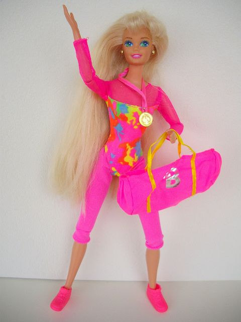 This was one of my first -- and definitely my favorite -- Barbies. She had more flexible joints than the average Barbie. :) Gymnast Barbie! She also came with dumbbells, hand ribbons, and a pink ribbon in her hair.