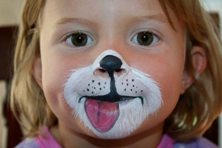 puppy face paint.  I didn't think about a tongue!  How cute!