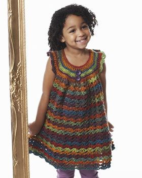 Fun crocheted girl's tunic that shows off the beautiful color changes of Bernat Mosaic!
