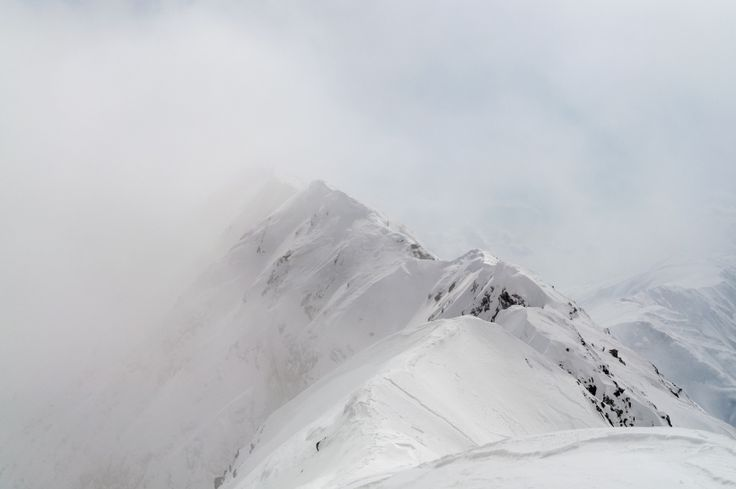 March 2016, Făgăraș Mountains. Fog lifts uncovering the narrow ridge between Romania's third highest summit, Viștea Mare, and it's highest, Moldoveanu. This image is taken from Viștea towards Moldoveanu, which is not yet seen