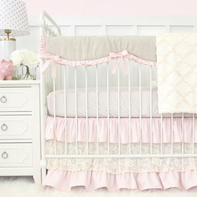 This 2 pc. set features a sweet taupe dot crib sheet and a gorgeous blush pink and ivory lace triple ruffle crib skirt. This crib bedding set will bring a look of elegance to any baby girl's nursery.