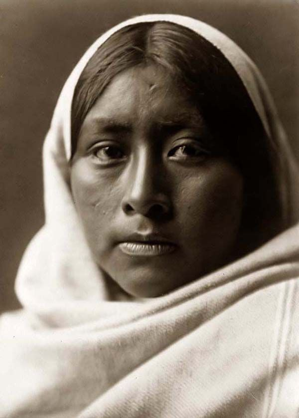 Here for your browsing pleasure is an extraordinary photo of a Papago Girl. It was made in 1907 by Edward S. Curtis.    The photo illustrates a bust portrait of a Papago Indian woman wrapped in a shawl.    We have compiled this collection of photos mainly to serve as a vital educational resource. Contact curator@old-picture.com.    Image ID# 0AF59E85