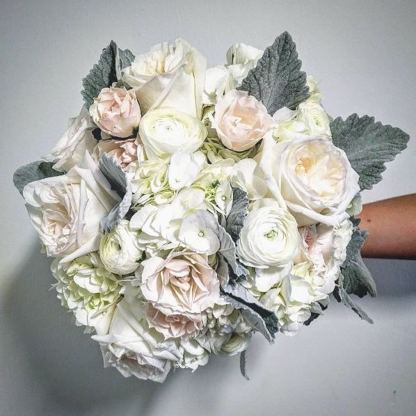 Soft and elegant summer wedding bridal bouquet  created by Peony House Floral Studio. O'hara rose, ranunculus, majolica spray roses, dusty miller, hydrangea, white spray roses...