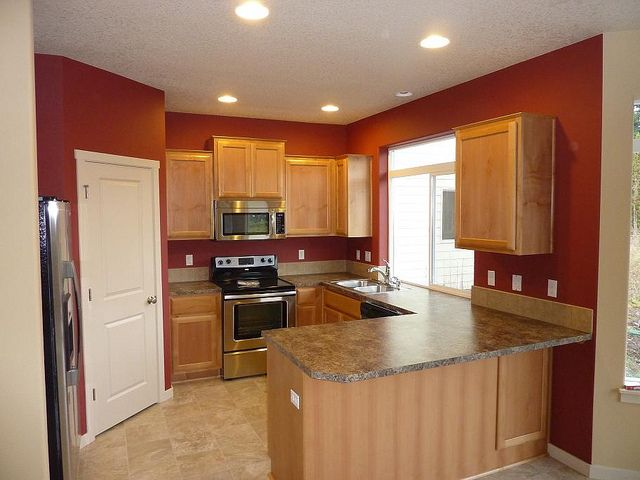 Similar kitchen cabinet and countertop colors, I dream of a red kitchen, now I'm thinking not so much.