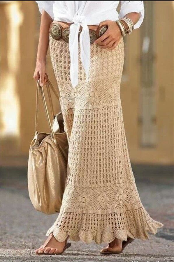 Crochet maxi skirt accessorized with extra wide leather belt and crisp-white shirt
