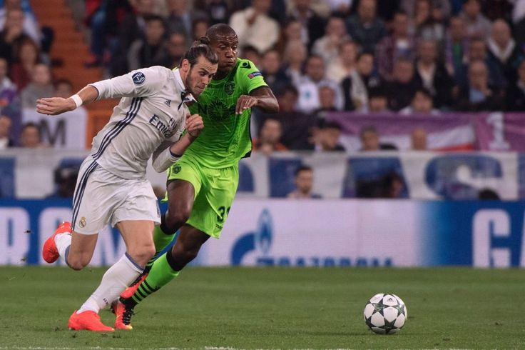 Real Madrid's Welsh forward Gareth Bale vies with Sporting's Dutch defender Marvin Zeegelaar during the UEFA Champions League football match Real Madrid CF vs Sporting CP at the Santiago Bernabeu stadium in Madrid on September 14, 2016.
