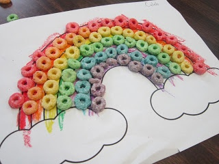 I've seen these rainbows made out of fruit loops on Pintrest and I thought, why not?  I'm so happy with the way this craft turned out. It's something that I plan on doing every year!  Follow the link for directions and the rainbow printable!