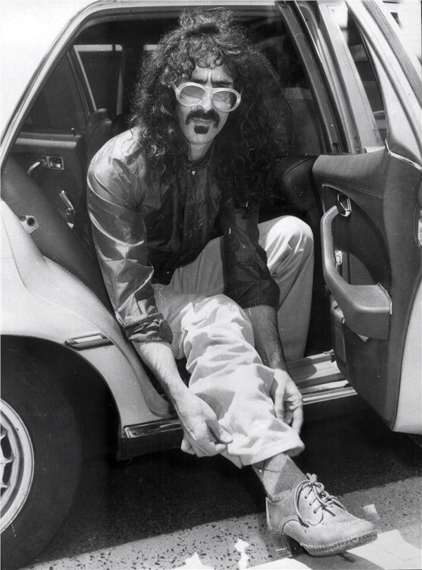 "Frank Zappa ""It wasn't very large There was just enough room to cram the drums In the corner over by the Dodge It was a fifty-four With a mashed up door And a cheesy little amp With a sign on the front said ""Fender Champ"" And a second hand guitar It was a Stratocaster with a whammy bar"""