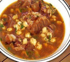 Pozole Rojo- Pozole (pronounced poh-soh-lay) is a traditional soup or stew made with hominy, pork (or other meat), chili pepper, and other seasonings. It is always served with a set of condiments for people to add themselves, to flavor it how they desire.