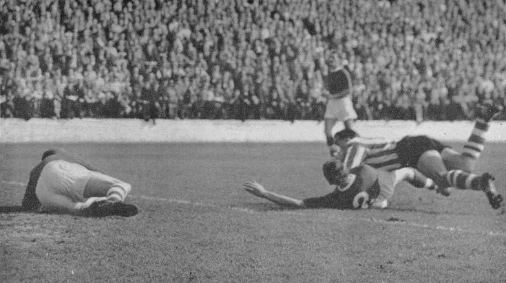 8th September 1956. Sheffield Wednesday winger Alan Finney scoring with a diving header against Charlton Athletic, at the Valley.