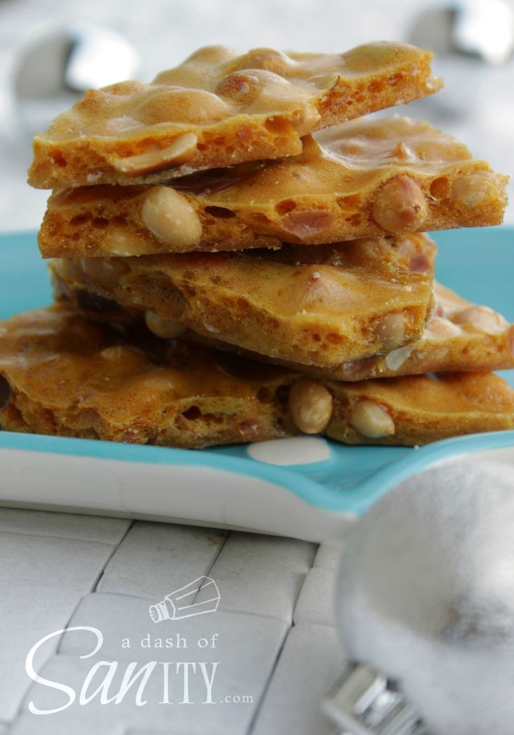 Peanut Brittle....Ingredients      2 cups sugar     1 cup corn syrup     ½ cup water     2 tablespoons butter + more for pan     2 ½ cups Spanish peanut...