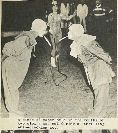 A piece of paper held in the mouths of two clowns was cut during a thrilling whip-cracking act. - Nelson Photo News - No 77 April 1, 1967