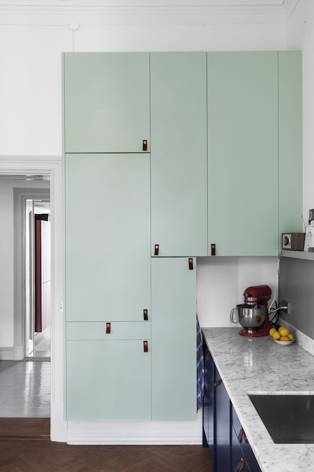 Aqua blue kitchen cabinets in a Swedish space. Entrance.