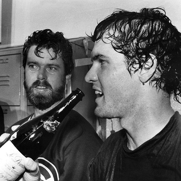 Ryne Sandberg and Rick Sutcliffe celebrate clinching the NL East on Sept. 24, 1984.
