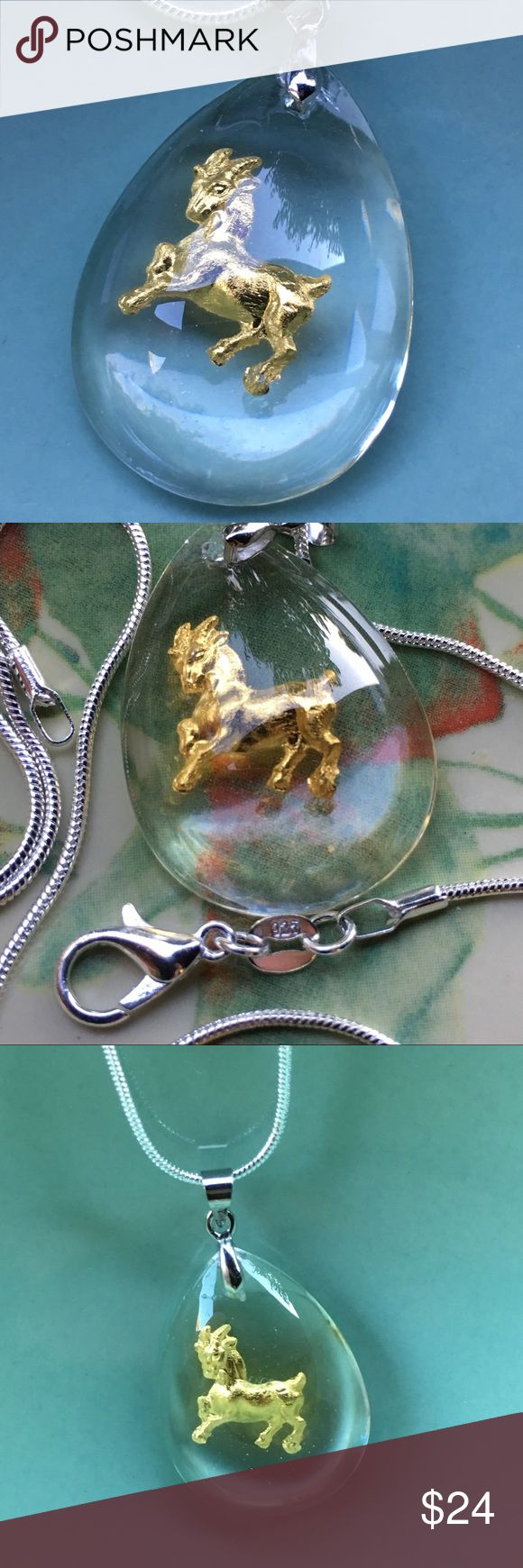 """Gold goat 🐐 sheep 🐑 ram pendant on silver chain Striking Golden goat 🐐 ram inside clear teardrop resin pendant. Hoop on pendant is 18k white gold filled. 24"""" Snake chain is .925 Sterling silver plated with a lobster claw clasp.  I also have available: angel, dog, rat, rooster, cat, butterfly 🦋, 🐯 tiger and other animals of the Chinese zodiac.  Farm animal - nice gift for luck. Jewelry Necklaces"""