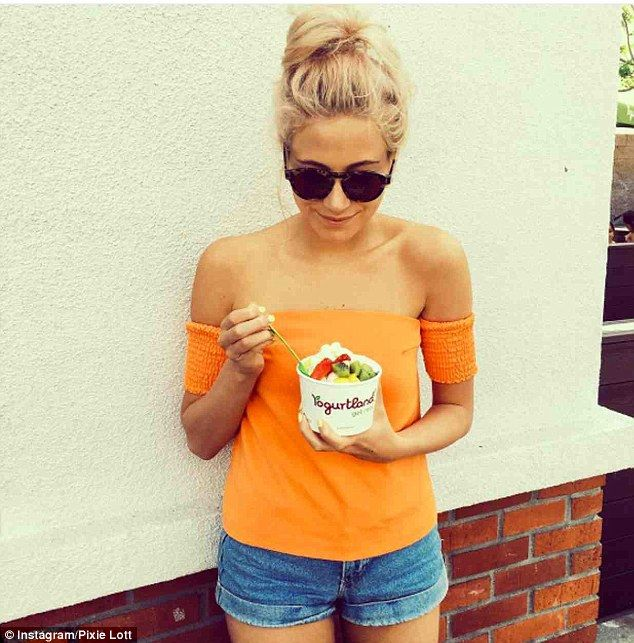 Fun in the sun: Teaming her skimpy shorts with a bright orange bardot top, the Mama Do hit...