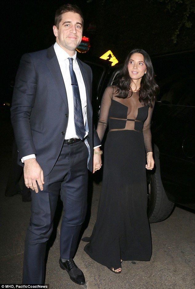 Date night: Olivia Munn held hands with her football playing boyfriend Aaron Rodgers as th...