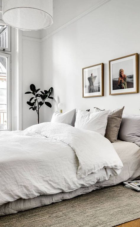 linen sheets, white and grey, photo prints, white walls, little tree