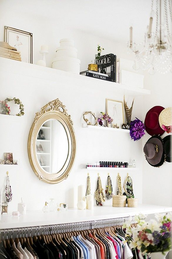 White closet with accessories and jewelry display.