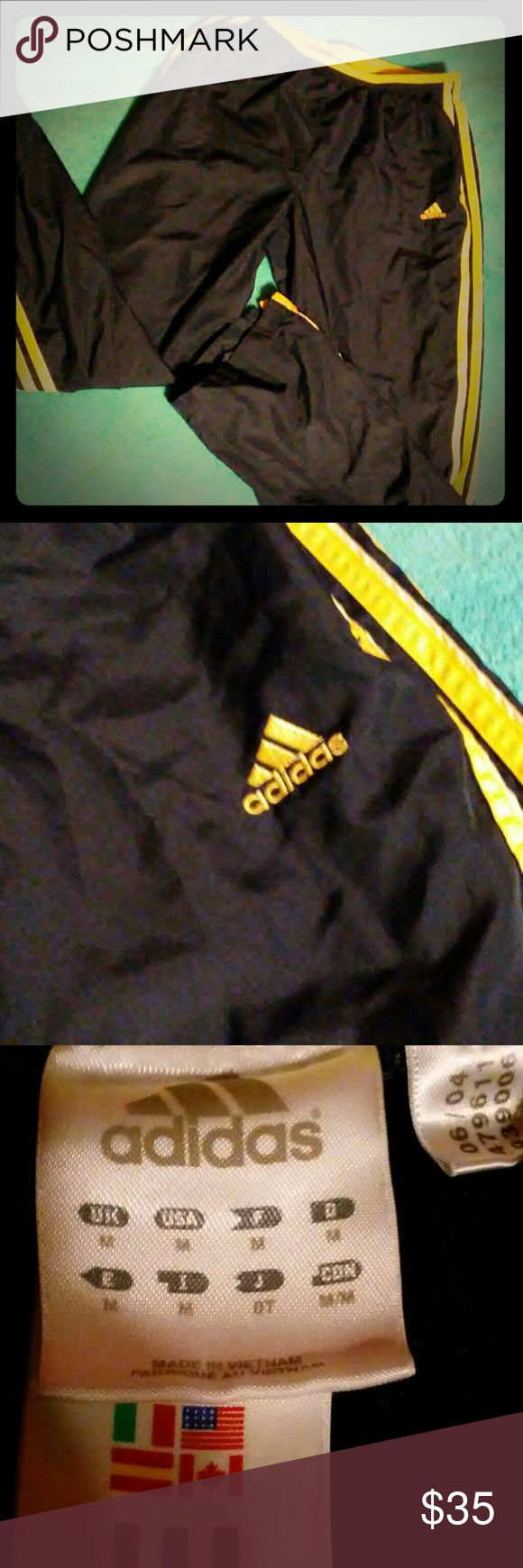 Women's windbreaker pants vintage Navy blue with light yellow stripes.  No imperfections Adidas  Pants Track Pants & Joggers