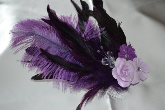 Dark purple feathers overlayed with light purple flowers. A crystal like butterfy peeks out between the flowers. Perfect for a bridesmaid or for a