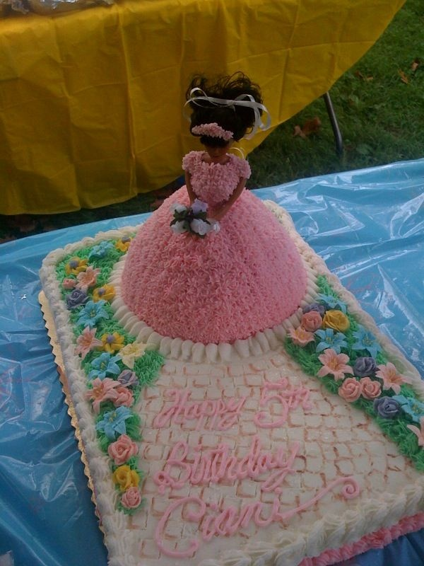 Princess doll cake - Princess doll on top of 1/2 sheet cake.