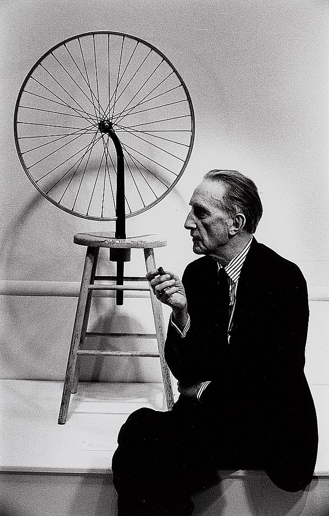 """Marcel Duchamp """"The wheel"""" 1913; The Bicycle Wheel, is the first of Duchamp's readymades, most of Duchamp's readymades were individual objects that he repositioned or signed and called art, the Bicycle Wheel on the other hand is what he called an """"assisted readymade,"""" made by combining more than one utilitarian item to form a work of art."""
