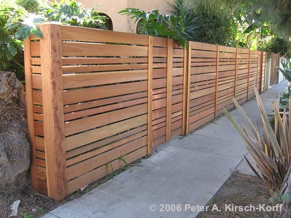 mid-century style privacy fence - i really like the varying board widths - makes a huge difference in visual interest