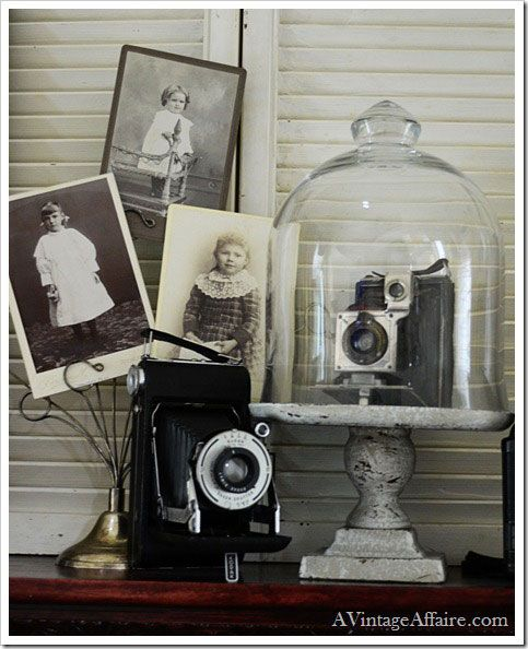 decorating with vintage cameras with black and white engagement photos