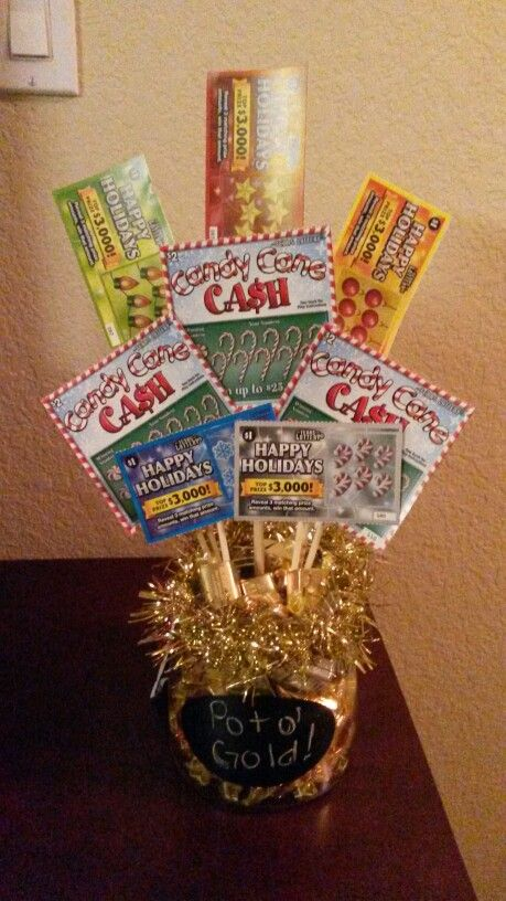 Pot of gold lottery ticket bouquet.  Gift idea Fill bottom with golden candies like Chocolate coins if you can find them, or Werther's, or Hershey's