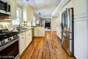 "Traditional Kitchen with Kitchen peninsula, Crown molding, Hardwood floors, 69"" Standard-Depth French Door Refrigerator"