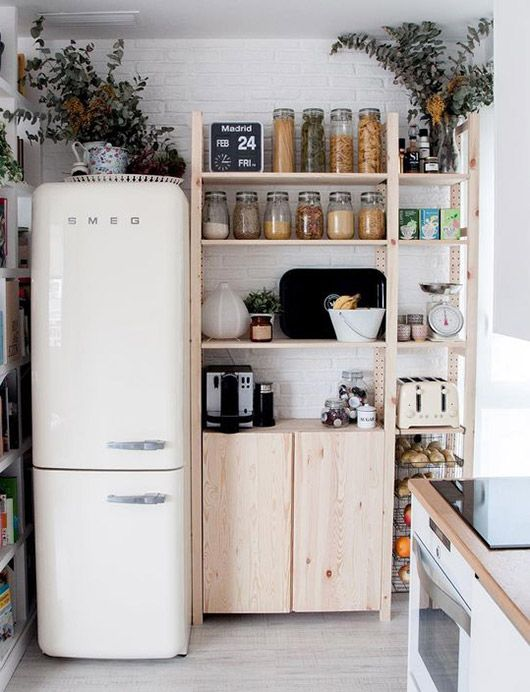 white smeg fridge in small modern kitchen. / sfgirlbybay