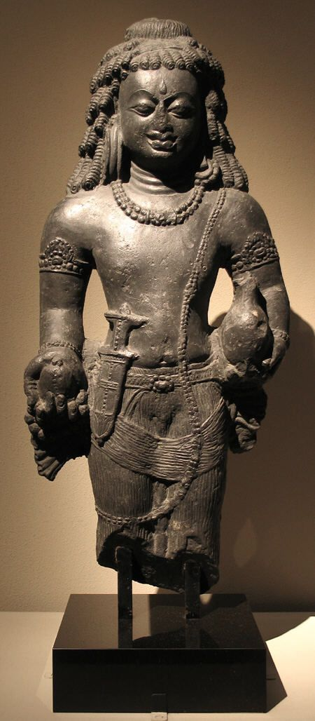 6th C. India. Standing Male Deity, possibly Lord Shiva, the massiveness of the body and hands seems to indicate a provincial version of the Gupta style practiced in Bihar. Stone.