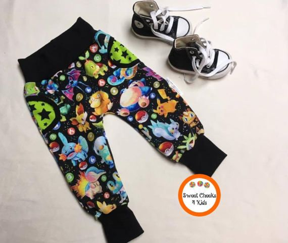 For the gamers, geeks and nerds with children, these pants were designed with you in mind! Any kids fortunate enough to own a pair of these adorable faux pocket pants will be the best dressed on the block. They are designed with a pokemon theme and are available with either all black waists and cuffs or contrasting green with black or white stars.       Pokemon Clothing, Kids Gamer Clothes Modern Kids Joggers, Trendy Kids Clothing, Pokemon Birthday Gift, Trendy Kids Clothes, Hipster Kids