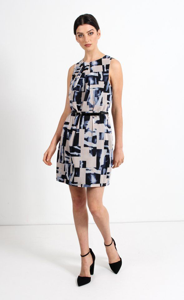 This dress will ensure an ultra-feminine style for your 9-5 day. Although relaxed in fit, the skinny patent belt creates a flattering feminine silhouette.
