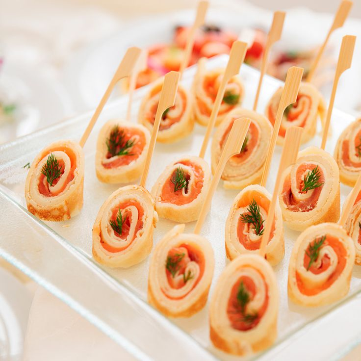 Flour tortillas wrapped with cream cheese, smoked salmon and infused with dill and chives.