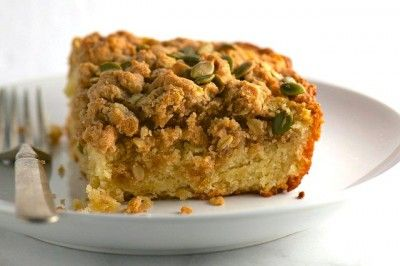 This is the Best Vegan Coffee Cake ever starting with a soft cake in the center with a crispy, crumbly topping with pumpkin seeds to finish it off.