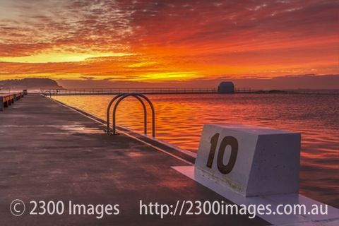 Ten out of Ten with the Rising Sun at Merewether Ocean Baths. - Looking north from the number ten block towards the colourful hues as the sun rises at...