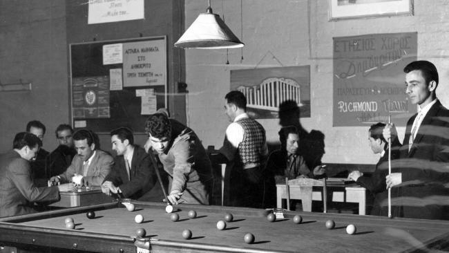 1957: Immigrant men play billiards in the Democritus Club Melbourne. Picture: Herald Sun Image Library