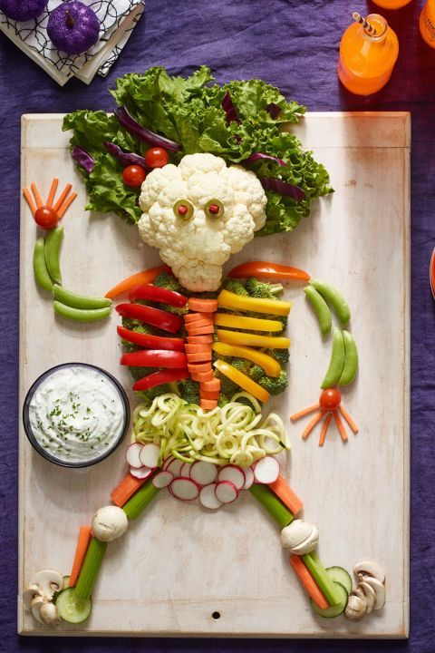 Skeleton Crudite: This Halloween appetizer is the perfect combination of scary and healthy! Halve, slice, or spiralize your veggies to create munchable bones and body parts. Find more easy, creepy and healthy Halloween appetizer ideas and recipes that are perfect for any Halloween party here.